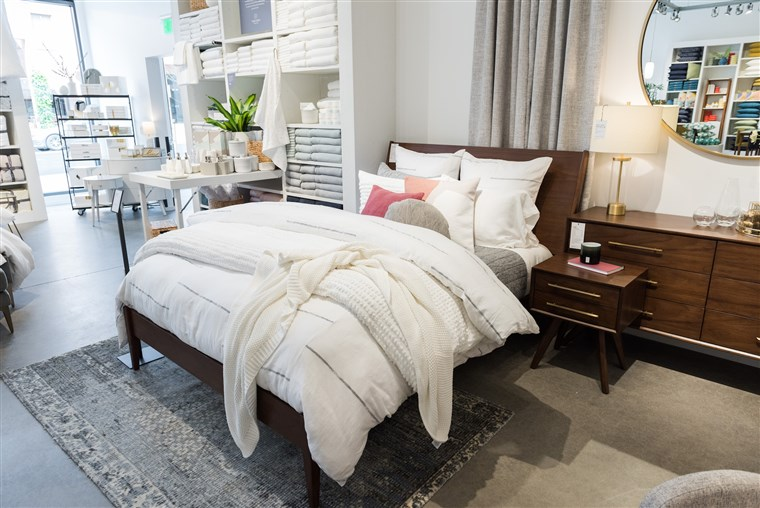 How to make your bed look like it belongs in a furniture sto
