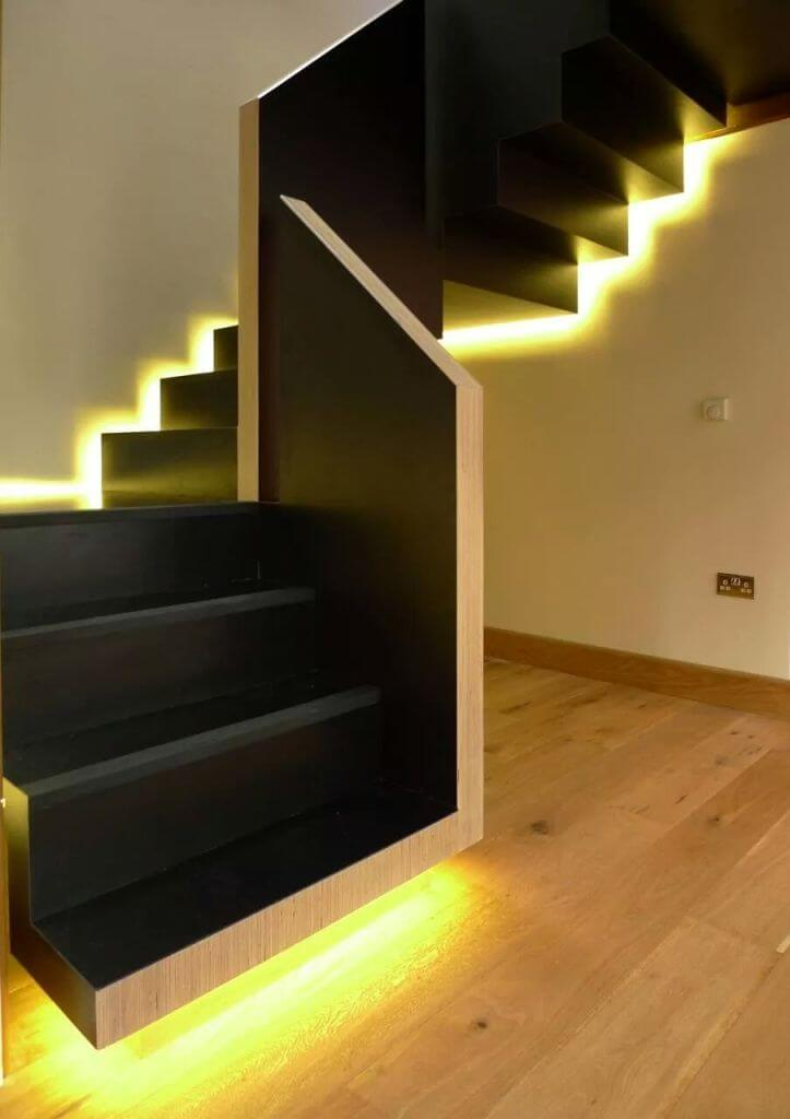 Yellow light on black stairs