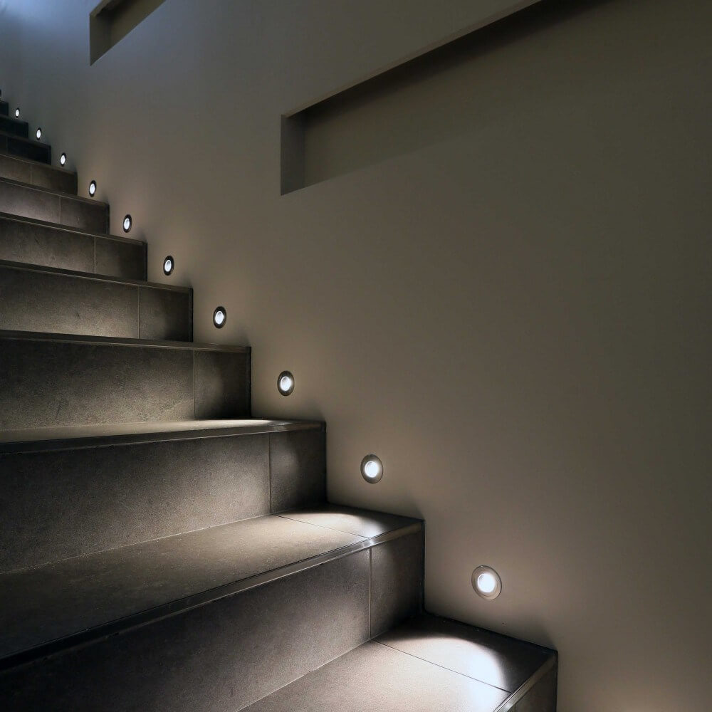 Wall recessed staircase light in each step