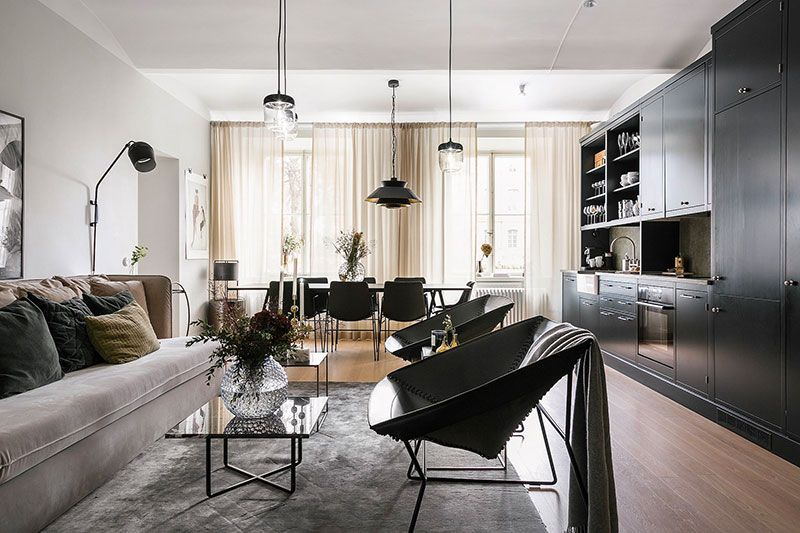 Swedish apartment with black kitchen and large windows (91 sqm .