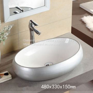 Bathroom ceramic new oval modern hand wash basin in factory price .