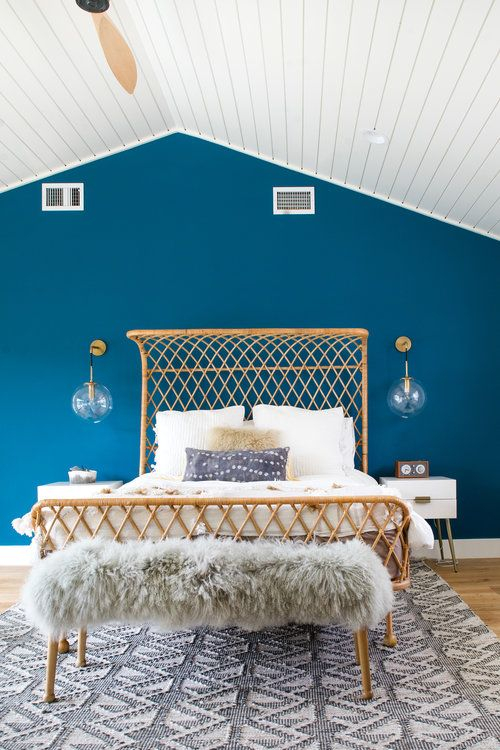Modern Bohemian Bedroom with Rattan Bed Frame and Bright Blue .