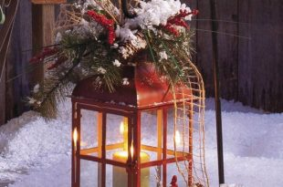A lantern makes a pretty outdoor holiday decoration .