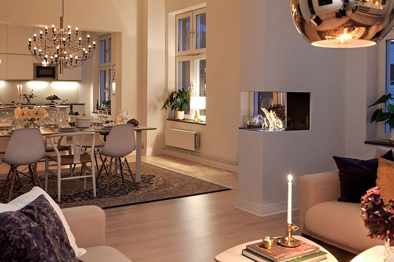 Scandinavian apartment with cozy atmosphere on evenings .