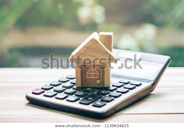 House Placed On Calculator Imagine Calculating Stock Photo (Edit .