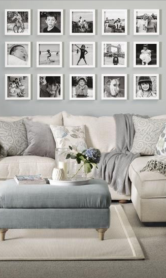 A black and white photo wall looks perfect in this white and grey .