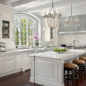 Modern French kitchen with white kitchen cabinets paired with .