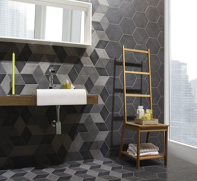 Contemporary geometric bathroom tiling - bit too much on floors .