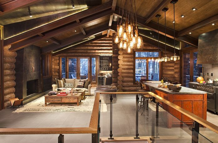 Beautiful open concept rustic kitchen/living room design by Studio .