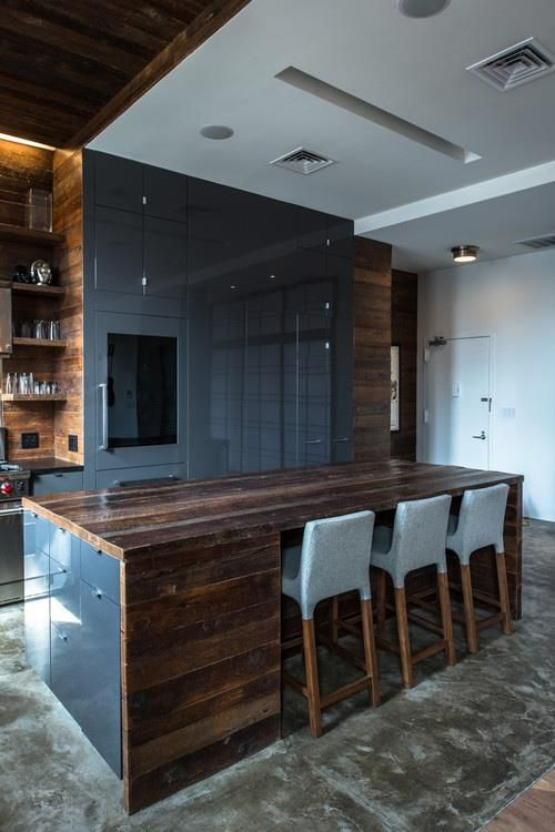 Unique countertop and blue cabinets in East Village PH apartment .