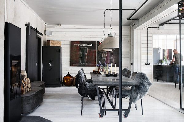 Cool industrial meets cosy rustic in a Swedish home conversion .