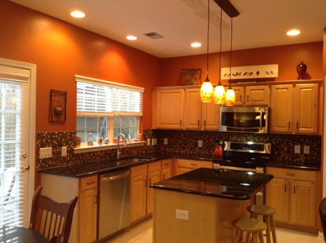 Burnt orange kitchen with new lighting! | Orange kitchen walls .