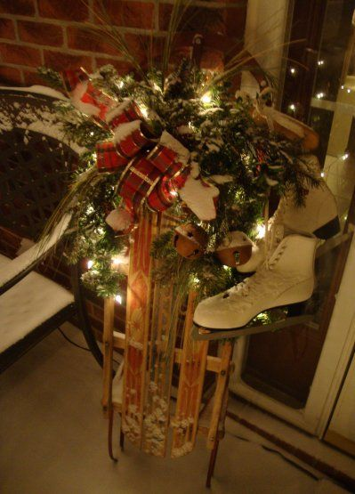 Decorate An Old Sled...with pine and lights & vintage ice skates .