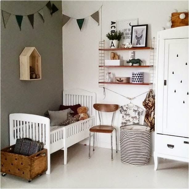 Love the dark wooden touches - a vintage and modern toddler room .