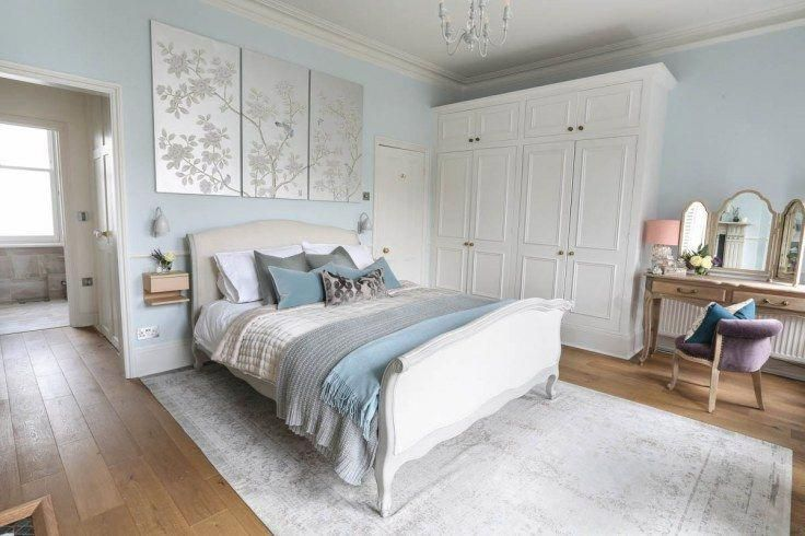 Soft hues of pale blue, grey and white give the bedroom a serene .