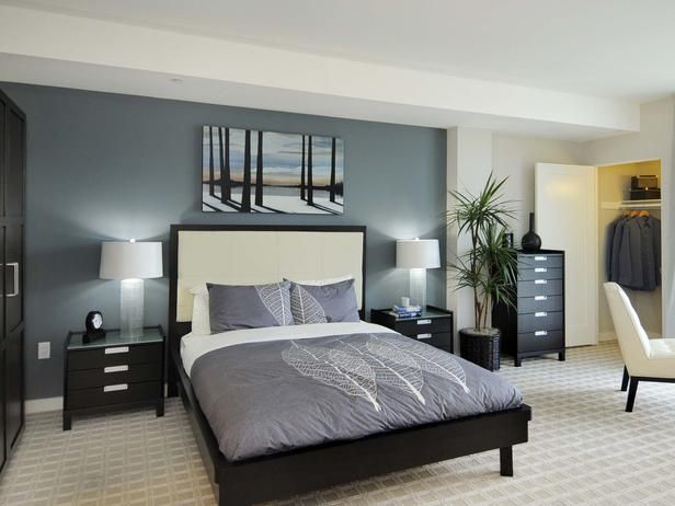 Sleek Sophisticated Bedroom: Calming blue hues and dark wood .