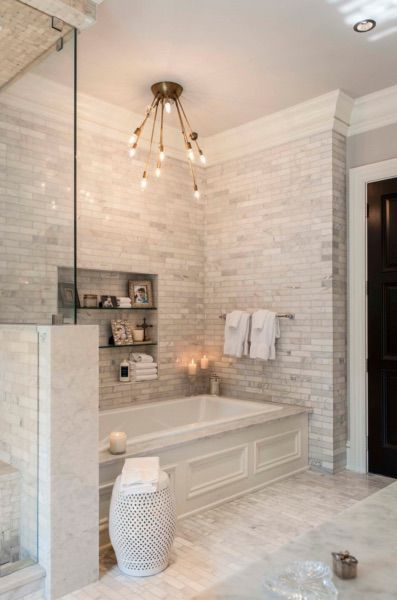 This stunning spa-like bathroom was completed by /davincimarble .