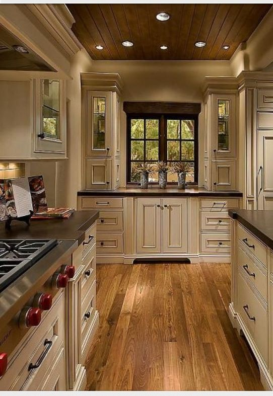Elegant but homey kitchen with vanilla bean colored cabinets mixed .
