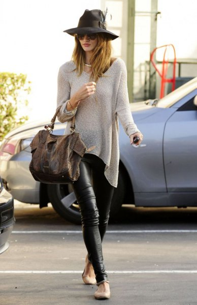 pale pink sweater and black leather gaiters