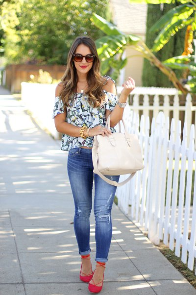 Orange flats with off-the-shoulder floral blouse in white