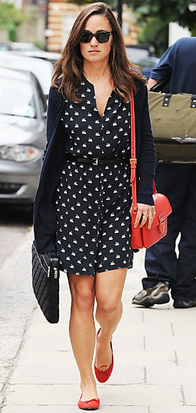 Red leather ballerinas with a black and white patterned shirt dress with belt