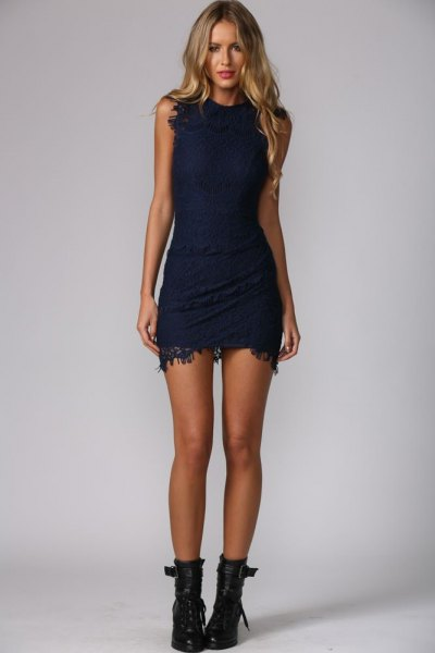 sleeveless, figure-hugging mini dress with leather ankle boots