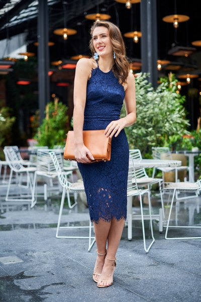 Navy midi bodycon lace dress with brown clutch