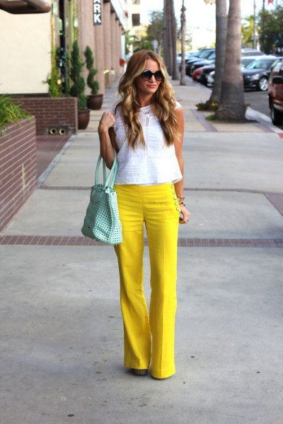 yellow flared sailor trousers with white sleeveless lace top