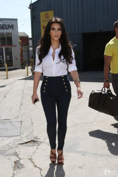 white shirt with buttons and dark blue, thin sailor trousers