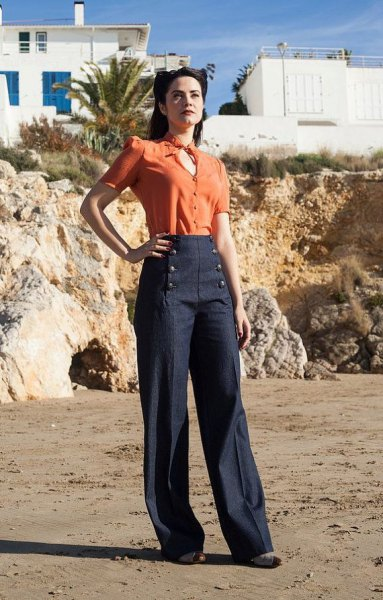 orange key hold blouse with dark blue sailor trousers with wide legs