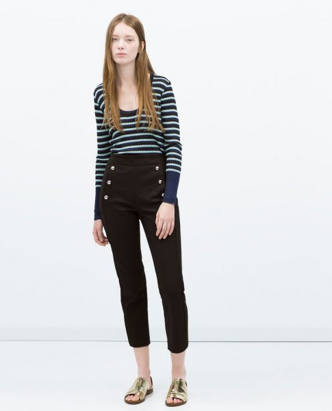 dark blue and white striped sweater with scoop neckline and black, shortened trousers