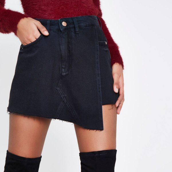 black skort with red fuzzy knit sweater