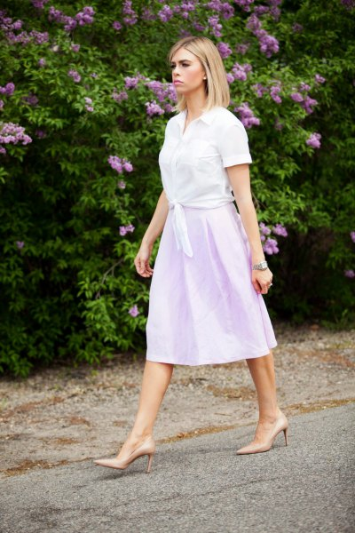 white knotted shirt with sky blue linen midi skirt