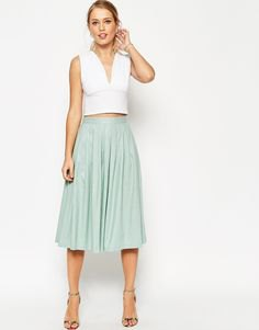 white sleeveless crop top with deep V-neck and gray linen skirt