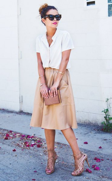 white shirt with buttons and light pink flared midi skirt