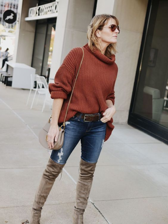 Thigh-high boots with a burnt orange sweater