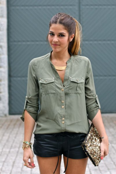 Army green shirt with buttons and black mini leather shorts