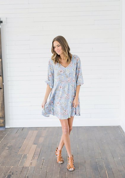 baby blue and white swing dress with floral pattern and half sleeves