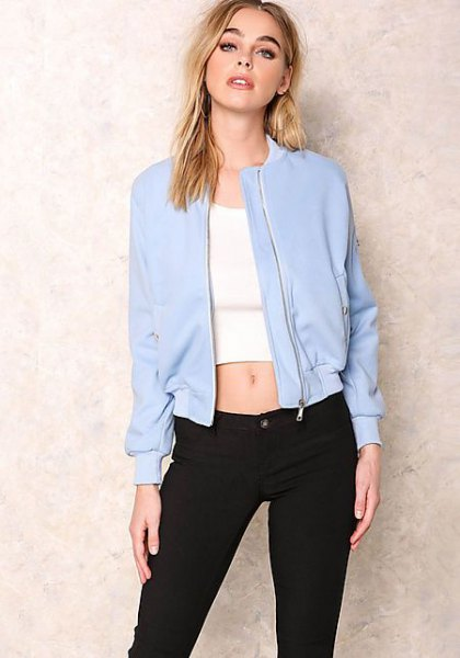 baby blue bomber jacket with white, short t-shirt and black slim fit jeans