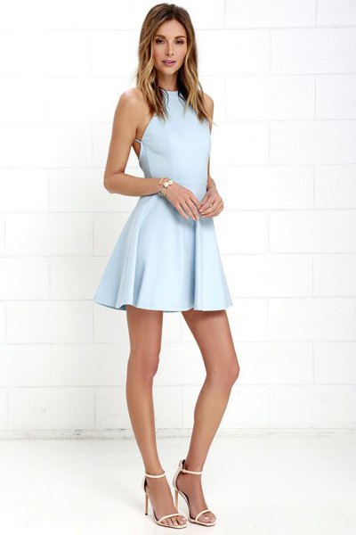 Baby blue halterneck fit and flared mini dress with white, open toe heels