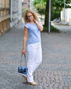 baby blue t-shirt with white jeans and a small jeans pocket