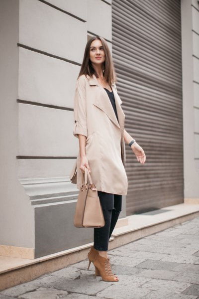 beige long trench coat with half sleeves and black vest