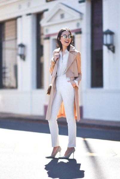 beige long trench coat with a completely white outfit