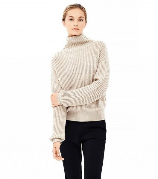beige tube sweater with mock neck, black tube jeans