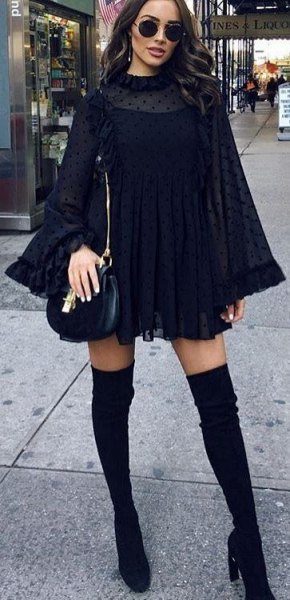 Mini shift dress with bell sleeves and mock neck and black leather bag