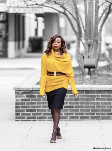 Half-sleeved pullover with belt over a yellow T-shirt with long sleeves