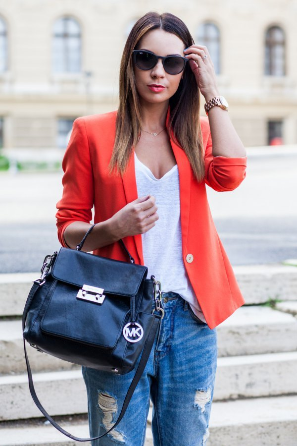 best orange blazer with white deep V-neck t-shirt and ripped jeans