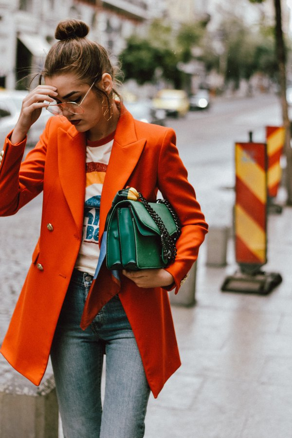 best orange oversized double-breasted suit with printed t-shirt and gray jeans