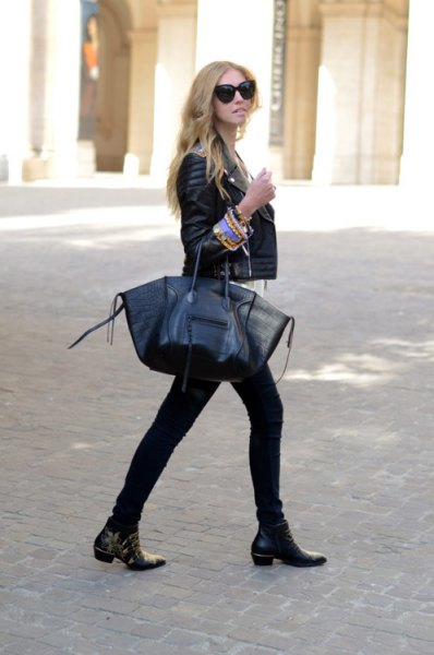 Biker jacket with skinny jeans and black leather boots