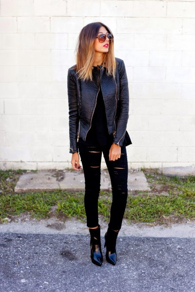 Biker leather jacket with ripped black skinny jeans and leather boots